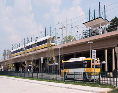 DART Light Rail Train with a DART Bus Below