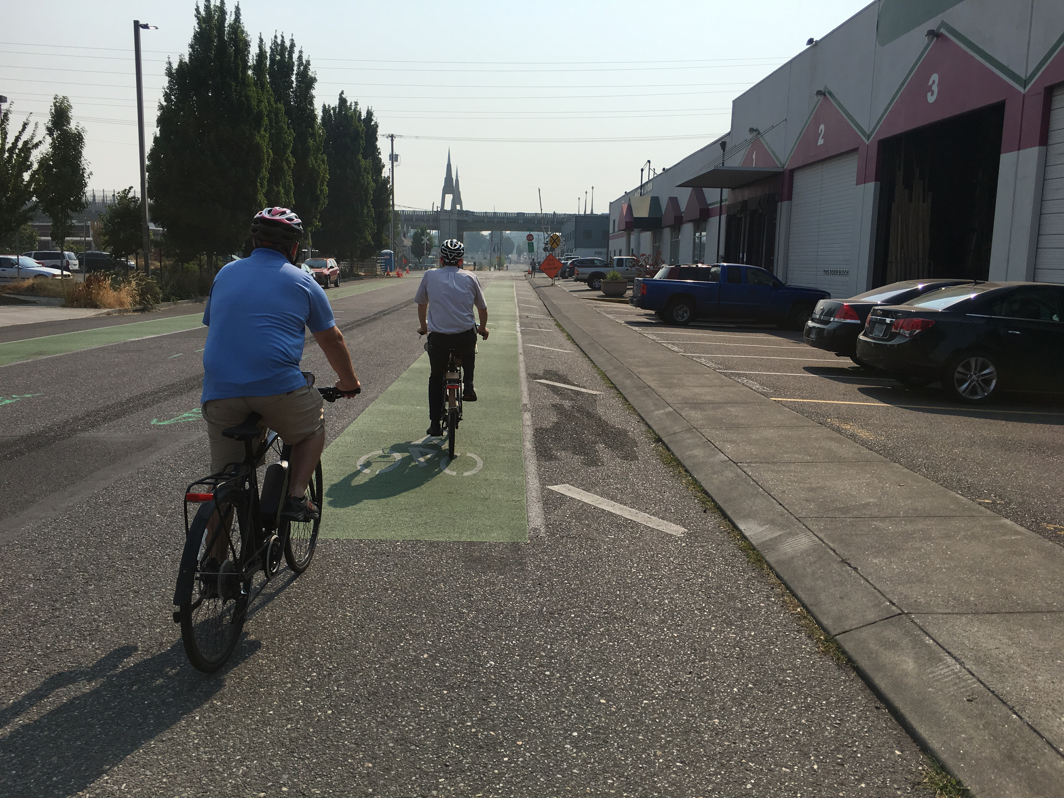 Individuals riding their bikes on a bike lane